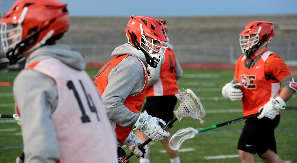 . ERIE CO: February 28, 2019:  Aiden Abram, center, during Erie lacrosse practice on Thursday. Erie High School is one of the new programs in lacrosse this upcoming spring. (Photo by Cliff Grassmick/Staff Photographer)