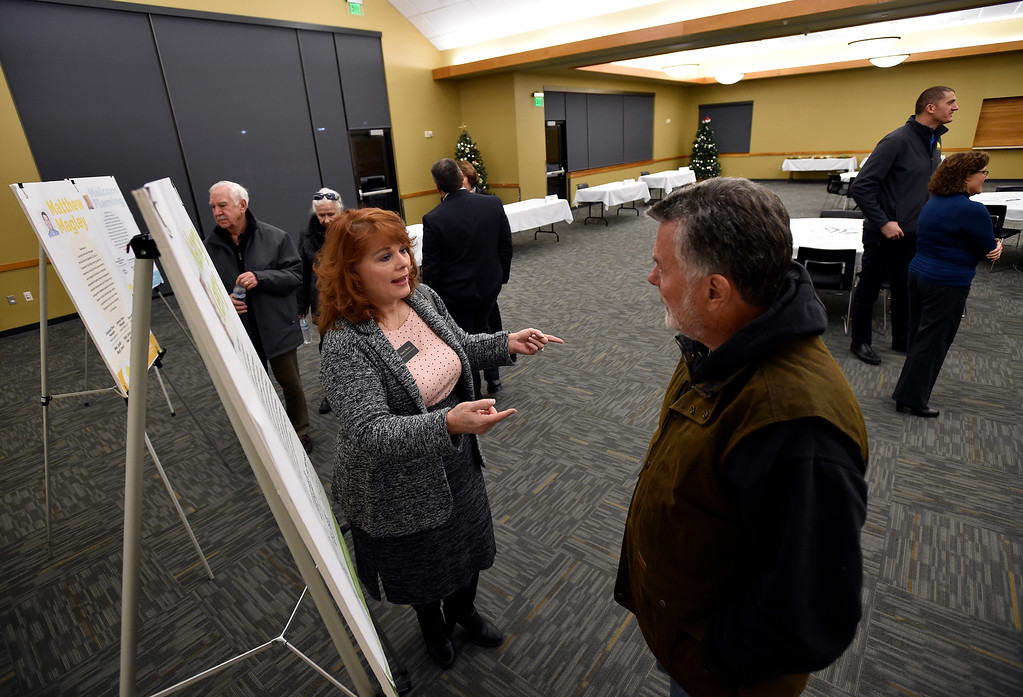 . ERIE, CO - DECEMBER 6, 2018: Candidate Nancy Kerry talks with Jim Stull, of Erie, during a Town of Erie Administrator open house on Thursday at the Erie Community Center in Erie. For more photos go to dailycamera.com (Photo by Jeremy Papasso/Staff Photographer)