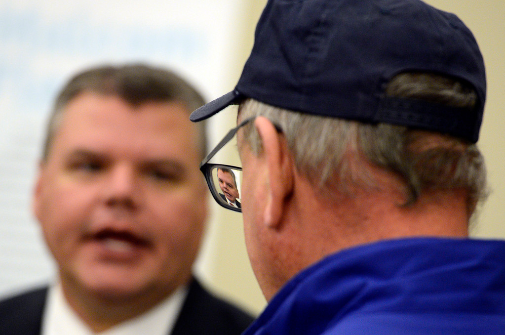 . ERIE, CO - DECEMBER 6, 2018: Candidate Matthew Magley is seen in the glasses of Mike Witt, of Erie, as they chat during a Town of Erie Administrator open house on Thursday at the Erie Community Center in Erie. For more photos go to dailycamera.com (Photo by Jeremy Papasso/Staff Photographer)
