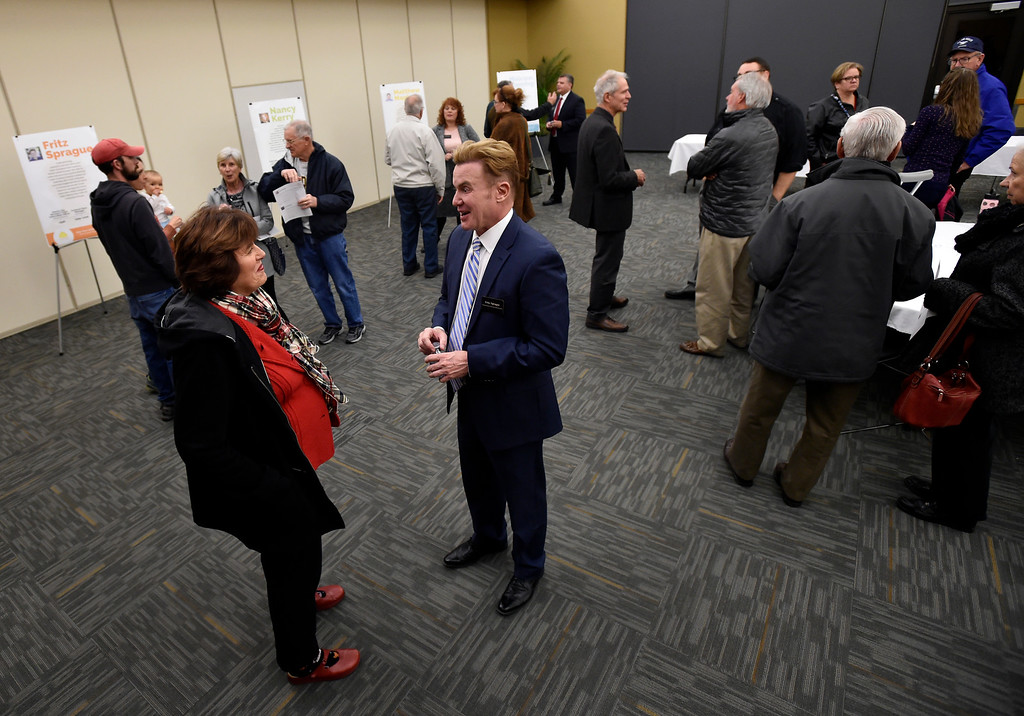 . ERIE, CO - DECEMBER 6, 2018: Jackie Connor, of Erie, talks with candidate Fritz Sprague during a Town of Erie Administrator open house on Thursday at the Erie Community Center in Erie. For more photos go to dailycamera.com (Photo by Jeremy Papasso/Staff Photographer)