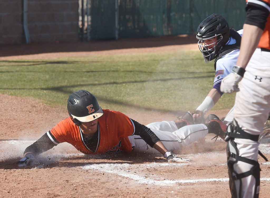 . Garrett Mayers, of Erie, is safe at home in front of the tag by Wayne Rode, of Holy Family, during the game at Holy Family in Broomfield on Saturday. For more photos, go to www.BoCoPreps.com Cliff Grassmick  Staff Photographer March 18, 2017