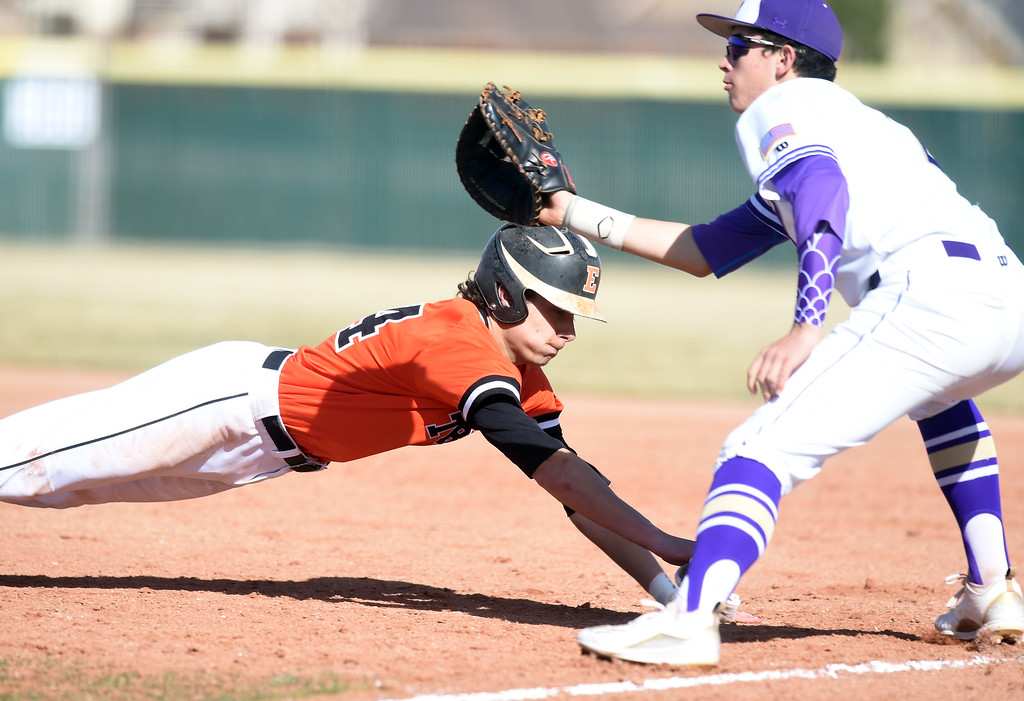 . Ethan Fiallo, of Erie, gets back to first before the tag of Colton Clingman, of Holy Family, during the game at Holy Family in Broomfield on Saturday. For more photos, go to www.BoCoPreps.com Cliff Grassmick  Staff Photographer March 18, 2017