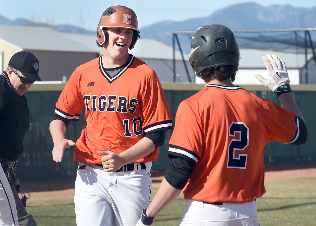 . Hunter Nelson, left of Erie, celebrates  2-run home run in the first inning with John Mirabass, during the game at Holy Family in Broomfield on Saturday. For more photos, go to www.BoCoPreps.com Cliff Grassmick  Staff Photographer March 18, 2017
