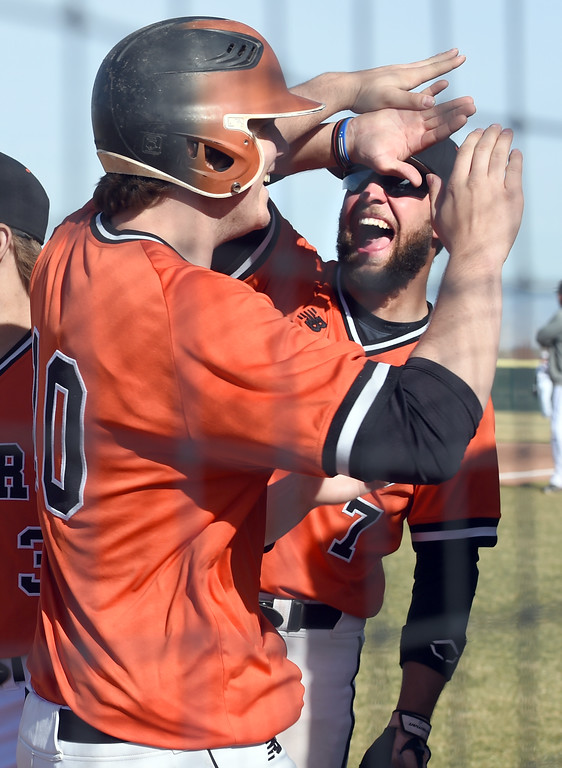 . Hunter Nelson, left of Erie, celebrates  2-run home run in the first inning with Zach Ellison, during the game at Holy Family in Broomfield on Saturday. For more photos, go to www.BoCoPreps.com Cliff Grassmick  Staff Photographer March 18, 2017