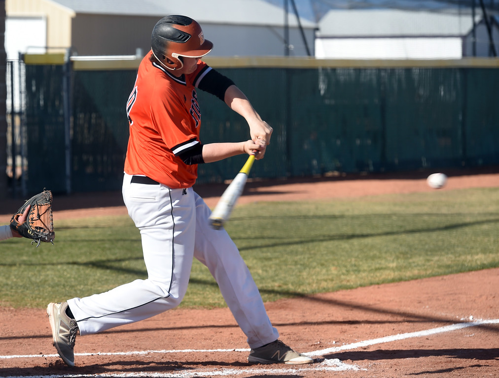 . Hunter Nelson, of Erie, hits a 2-run home run in the first inning during the game at Holy Family in Broomfield on Saturday. For more photos, go to www.BoCoPreps.com Cliff Grassmick  Staff Photographer March 18, 2017