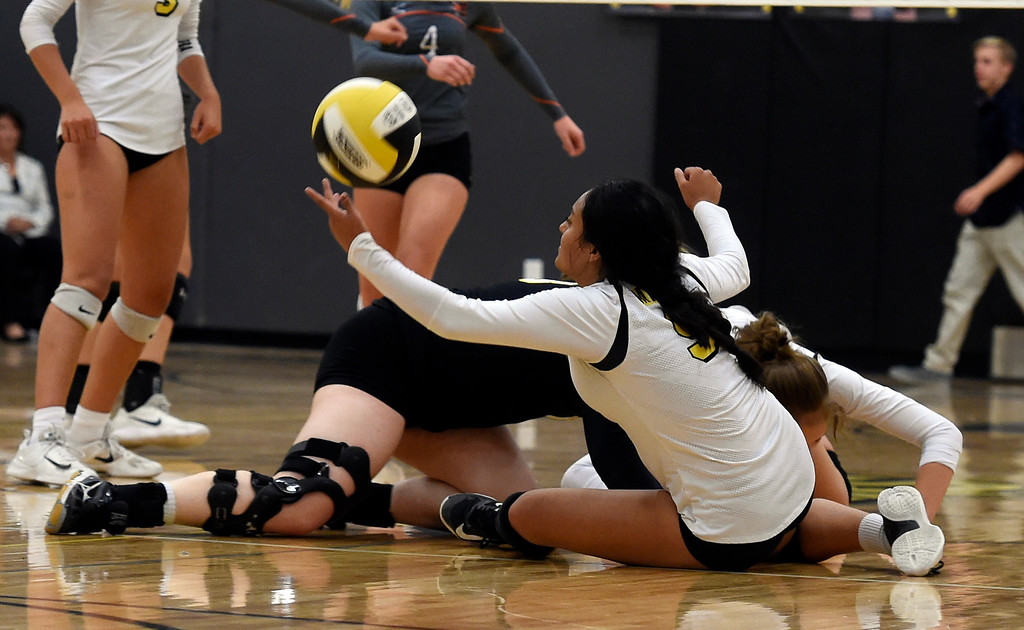 . BROOMFIELD, CO: September 11:  Destiny Castro, of Prospect Ridge, tries to keep the ball alive against Erie during the game at Prospect Ridge Academy in Broomfield. (photo by Cliff Grassmick/Staff Photographer).