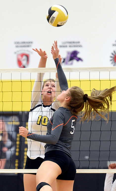 . BROOMFIELD, CO: September 11:  Sierra Leopold, left, of Prospect Ridge, and Jessica Amend, of Erie, battle at the net during the game at Prospect Ridge Academy in Broomfield. (photo by Cliff Grassmick/Staff Photographer).