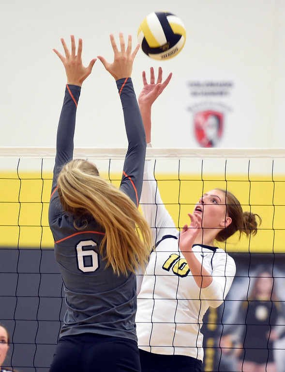 . BROOMFIELD, CO: September 11: Sierra Leopold, right, of Prospect Ridge, tries to hit over Addyson Huber, of Erie,  during the game at Prospect Ridge Academy in Broomfield. (photo by Cliff Grassmick/Staff Photographer).