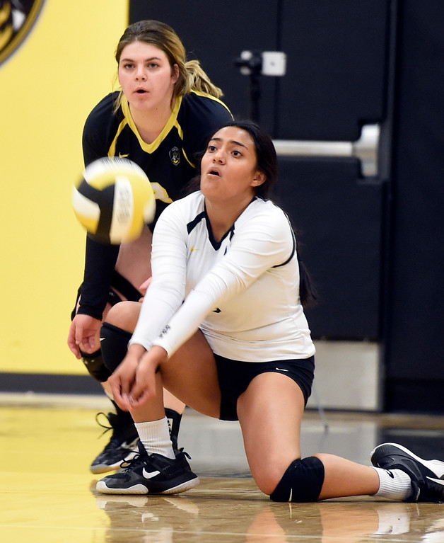 . BROOMFIELD, CO: September 11:  Destiny Castro, of Prospect Ridge, digs out an Erie serve during the game at Prospect Ridge Academy in Broomfield. (photo by Cliff Grassmick/Staff Photographer).