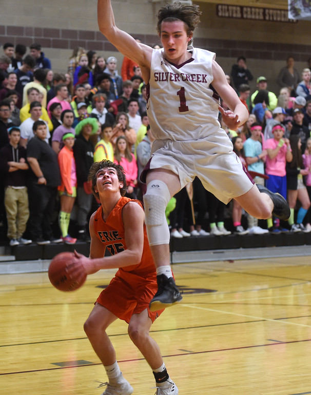 . Nick Eaton, of Silver Creek, flies past Luke Loy, of Erie. For more photos, go to BoCoPreps.com.  Cliff Grassmick / Staff Photographer/ February 24, 2018