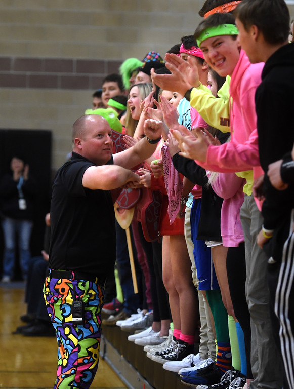 . Silver Creek Athletic Director, Kyle Schuyler, gets the student section fired up.  For more photos, go to BoCoPreps.com.  Cliff Grassmick / Staff Photographer/ February 24, 2018