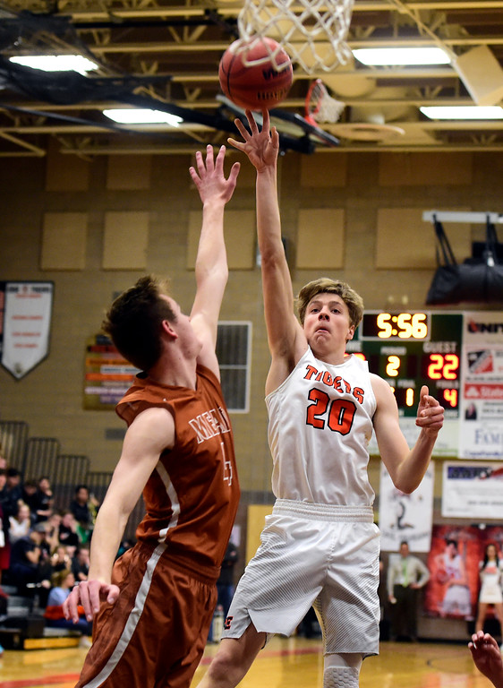 . Erie High School\'s Jeffrey Farineau takes a shot over David Wilhelm during a game against Mead on Tuesday in Erie. More photos: BoCoPreps.com Jeremy Papasso/ Staff Photographer 01/30/2018