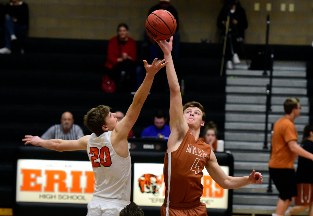 . Mead High School\'s David Wilhelm wins the tip-off against Jeffrey Farineau during a game against Erie on Tuesday in Erie. More photos: BoCoPreps.com Jeremy Papasso/ Staff Photographer 01/30/2018