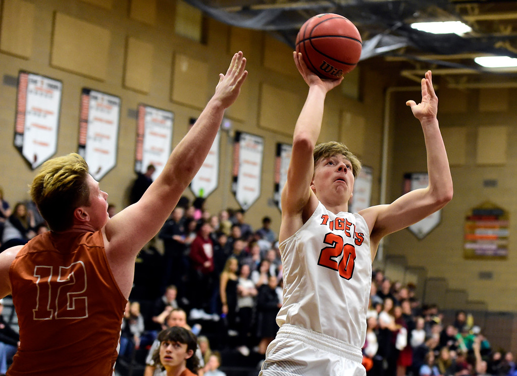 . Erie High School\'s Jeffrey Farineau takes a shot over Derek Edwards during a game against Mead on Tuesday in Erie. More photos: BoCoPreps.com Jeremy Papasso/ Staff Photographer 01/30/2018