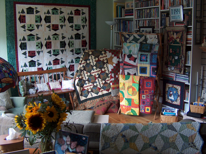 My house has never been this clean or had so many quilts in it.  Everyone came over the day befor the show and helped me clean and display all the quilts.  I had to borrow quite a few quilts back from their owners.