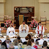 From left, The Rev. Teresa L. Fry Brown, Virginia Carr, The Rev. Robert Michael Franklin, Jr., Luke Fodor and James Arends prepare for the Communion at the Amp on Sunday, July 9, 2017. ERIN CLARK / STAFF PHOTOGRAPHER