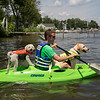 Mike Schreiner takes his dogs, Willie, left, and Watson, right, out kayaking off of the docks in Chautauqua Lake on Saturday, June 17, 2017. Schreiner is a 4th generation Chautauquan from Atlanta, GA. ERIN CLARK / PHOTOGRAPHER
