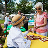 "Jeannette Kahlenberg, right, buys Mary Anne Morefield's second published book, ""No bridle, no bits, no reigns"" at The Chautauqua Literary Arts Friends book fair on Bestor Plaza on Sunday, July 9, 2017. ERIN CLARK / STAFF PHOTOGRAPHER"