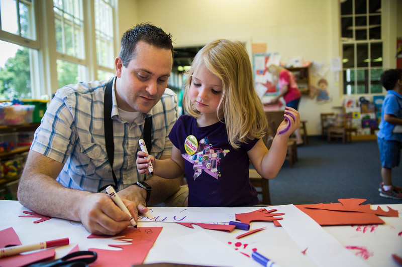 Brandon Hicks helps daughter Anabelle, 3, write her name at the Children's School open house on Friday, July 14, 2017. ERIN CLARK / STAFF PHOTOGRAPHER