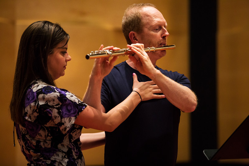 Richard Sherman, the Rita and Dunbar VanDerveer Symphony Principal Chair for Flute, teaches proper breaching practices to Jennie Cross during a Master Flute class in Fletcher Music Hall on Monday, July 24, 2017. ERIN CLARK / STAFF PHOTOGRAPHER