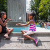 Aliya Alsworth, left, and Sofia Toribio play with bubbles in the Bestor Plaza Fountain on Sunday, July 23, 2017. ERIN CLARK / STAFF PHOTOGRAPHER