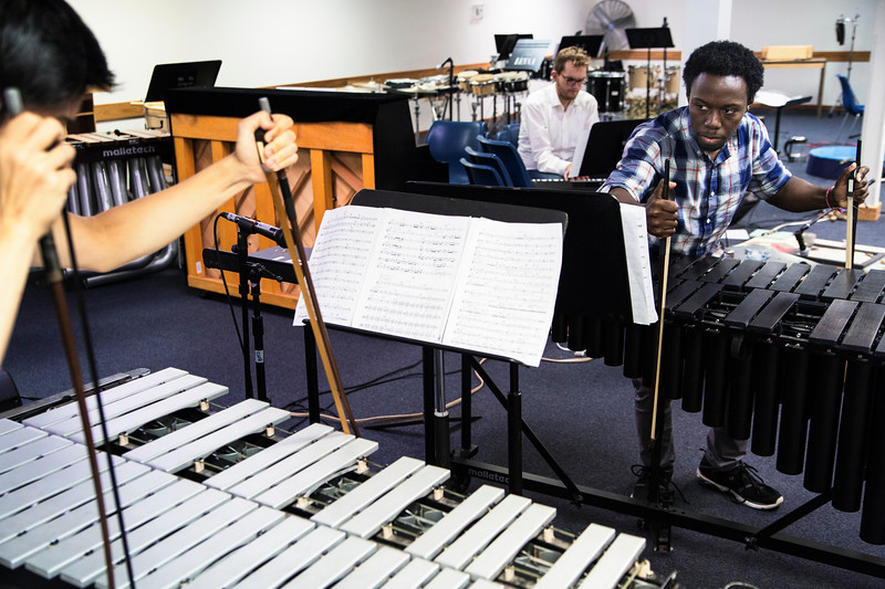 Miles Kim, left, and Josh Jones, percussion students, rehearse on the vibraphone in Bellinger Assembley in preparation for their recital on Wednesday, August 2, 2017. ERIN CLARK / STAFF PHOTOGRAPHER