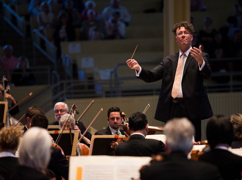 Steven Osgood, General and Artistic Director of the Chautauqua Opera Company, conducts the Chautauqua Symphony Orchestra during the Opera Highlights Concert in the Amp on Saturday, July 15, 2017. ERIN CLARK / STAFF PHOTOGRAPHER