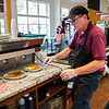Paul Smith prepares breakfast at the Brick Walk Cafe on Friday, July 20, 2017. ERIN CLARK / STAFF PHOTOGRAPHER