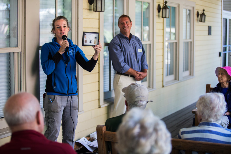 "Betsy Burgeson, Supervisor of Gardens and Landscaping, and John Sheds, director of operations, talk about ""Tree Maintenance and Our Environment"" during the Institution Leadership Porch Discussion on Hultquist Center porch on Wednesday, July 26, 2017.  ERIN CLARK / STAFF PHOTOGRAPHER"