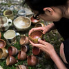 Yewen Dong, a VACI School of Art student, inspects her pinch cups recently unloaded from the kiln on Friday, July 15, 2017. ERIN CLARK / STAFF PHOTOGRAPHER