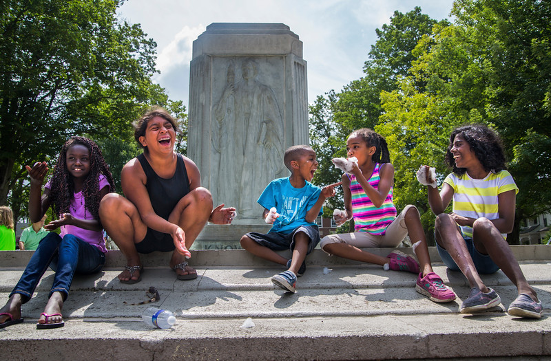 From left, Kira Alsworth, Aliya Alsworth, Alejandro Toribio, Sofia Toribio, and Subha Alsworth play with bubbles in the Bestor Plaza Fountain on Sunday, July 23, 2017. ERIN CLARK / STAFF PHOTOGRAPHER