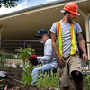 Chris Hoeft, right, of Mayville, NY, works to finish the landscaping around the Ampitheater with fellow staff member, Dewey Carlson, right, of Jamestown, NY on Wednesday, June 21, 2017. Hoeft has been on the Chautauqua Gardens and Landscaping crew for 5 seasons. ERIN CLARK / STAFF PHOTOGRAPHER