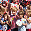 Children sing songs on the Collonade porch during the Children's Independence Day Parade on Tuesday, July 4, 2017. ERIN CLARK / STAFF PHOTOGRAPHER