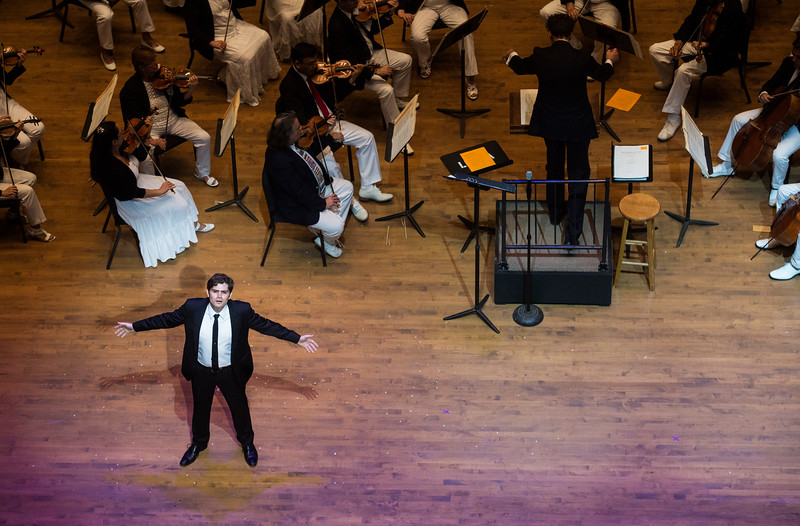 """Arnold Livingston Geis performs Gity Razaz' """"Flight of Faith"""", text by Marion Strobel, at the Chautauqua Symphony Orchestra Opera Highlights Concert in the Amp on Saturday, July 15, 2017. ERIN CLARK / STAFF PHOTOGRAPHER"""