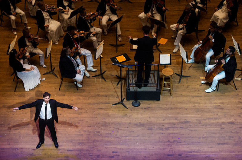 "Arnold Livingston Geis performs Gity Razaz' ""Flight of Faith"", text by Marion Strobel, at the Chautauqua Symphony Orchestra Opera Highlights Concert in the Amp on Saturday, July 15, 2017. ERIN CLARK / STAFF PHOTOGRAPHER"