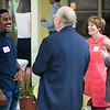 CTC Conservatory Actor Siddiq Saunderson talks with Board of Trustees Chair Jim Pardo, CEO of The Chautauqua Foundation Geof Follansbee and Gay Didget during the Lewis Miller Circle Reception at the President's Cottage on Thursday, August 3, 2017. ERIN CLARK / STAFF PHOTOGRAPHER