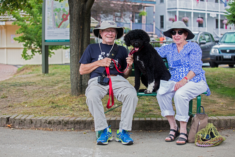 Tom and Marilynn Oelsner spend the afternoon with their Portugese Water Dog, Kismet, outside of the Amp on Sunday afternoon, July 23, 2017. ERIN CLARK / STAFF PHOTOGRAPHER