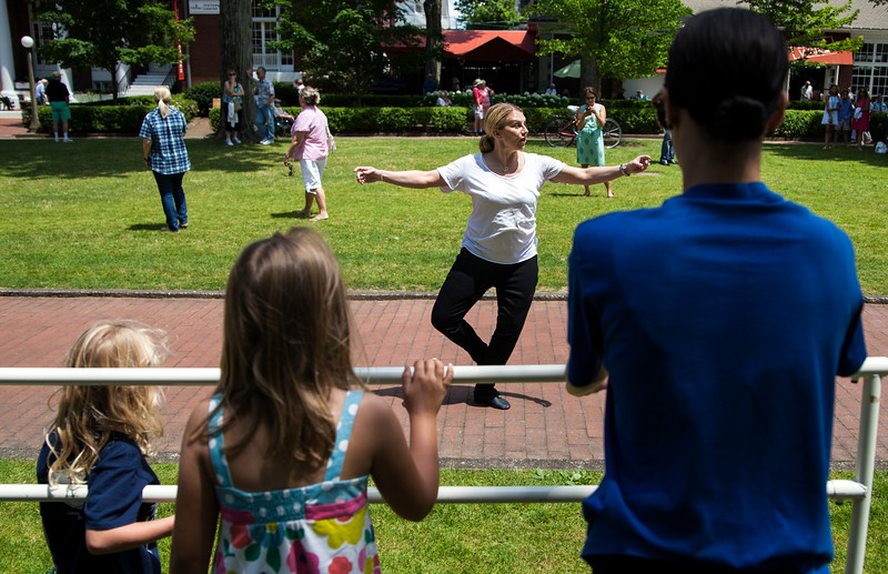 Hope Muir, incoming Artistic Director of The Charlotte Ballet, demonstrates movements during Sunday's Barre on Bestor Plaza on July 9, 2017. ERIN CLARK / STAFF PHOTOGRAPHER