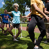 Rachel Rogers, center, practices movements with The Charolotte Ballet during Sunday's Barre on Bestor Plaza on July 9, 2017. ERIN CLARK / STAFF PHOTOGRAPHER