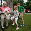 Members of the Kilpatrick family, Elizabeth, Ron, Caroline, and Henry, left to right, play with Tyrion, a maltese named after a Game of Thrones character on Monday, June 19, 2017. ERIN CLARK / STAFF PHOTOGRAPHER