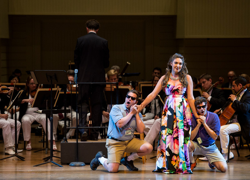 """From left, Mario Diaz-Moresco, Natalie Rose Havens, and Arnold Livingston Geis perform W.A. Mozart's """"Alla bella Despinetta"""" from """"Cosi fan tutte"""" at the Chautauqua Symphony Orchestra Opera Highlights Concert in the Amp on Saturday, July 15, 2017. ERIN CLARK / STAFF PHOTOGRAPHER"""