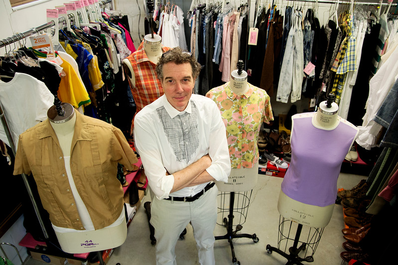 Visiting costume designer Richard St. Clair stands with costumes he purchased for Detroit '67 in the Brawdy Theater Studios costume shop on Thursday, July 20, 2017. ERIN CLARK / STAFF PHOTOGRAPHER