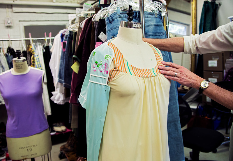 Visiting costume designer Richard St. Clair prepares costumes for Detroit '67 in the Brawdy Theater Studios costume shop on Thursday, July 21, 2017. ERIN CLARK / STAFF PHOTOGRAPHER