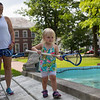 Carrie Zachry of Fort Worth, Texas watches as daughter, Parks Zachry, 2, balances on the Bestor Plaza fountain on Friday, June 18, 2017. A 5th generation Chautauquan, Zachry has been coming to Chautauqua since she was a child. ERIN CLARK / STAFF PHOTOGRAPHER
