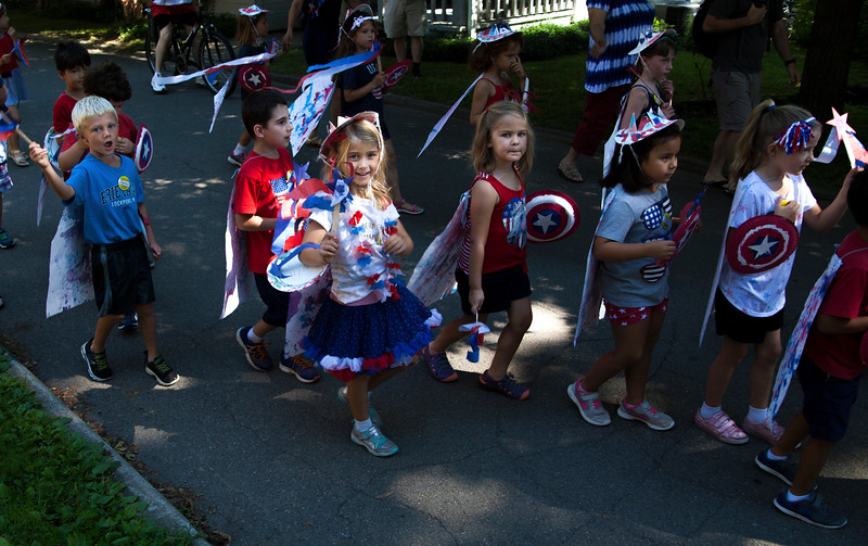 Children march from school during the Children's School Independence Day Parade on Tuesday, July 4, 2017. ERIN CLARK / STAFF PHOTOGRAPHER