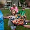 Baileigh Carter, a server from La Familia Restaurant, serves samples of a mediterranean stew to the Kilpatrick family on Monday, June 19, 2017. ERIN CLARK / STAFF PHOTOGRAPHER