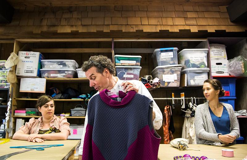 Visiting costume designer Richard St. Clair prepares costumes for Detroit '67 in the Brawdy Theater Studios costume shop with Lauren Venezia, left, and Cody Lorich. ERIN CLARK / STAFF PHOTOGRAPHER