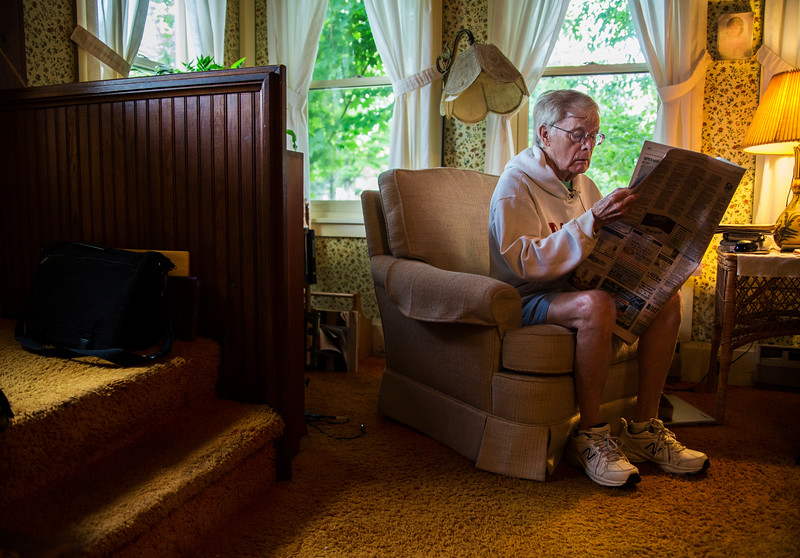 Bud Horne looks for his Letter to the Editor in The Chautauquan Daily in his home on Saturday, July 29, 2017. Horne wrote a list of Unofficial Rules for the Old First Night Race for his fellow runners and walkers. ERIN CLARK / STAFF PHOTOGRAPHER