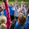 "Members of ""The Moms"" softball team do a cheer before they face off the ""Hot Chauts"" at Sharpe Field on Tuesday, July 25, 2017. ERIN CLARK / STAFF PHOTOGRAPHER"