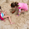 "Hana Pratt, 6, helps build a small lake for her Barbies with Maddie Hall, 7, at the Children's Beach on Monday, June 19, 2017. It was the first time that the two had been on a ""beach"", as well as their first time they have visited Chautauqua. The girls, both from Husdson, Ohio, are visiting the grounds for a week with their families. ERIN CLARK / STAFF PHOTGRAPHER"